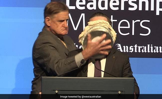 Qantas Airways CEO Alan Joyce hit with pie in the face (Video)