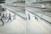 Heroic man saves suicidal woman from jumping in front of train (Video)