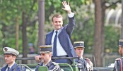Macron vows to overcome divisions in society