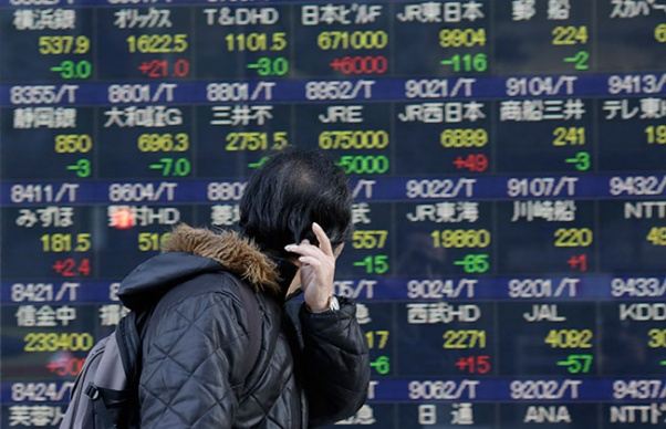 Asian stocks mixed after Wall Street rise