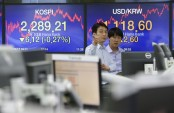 Asian stocks mostly lower amid political uncertainties