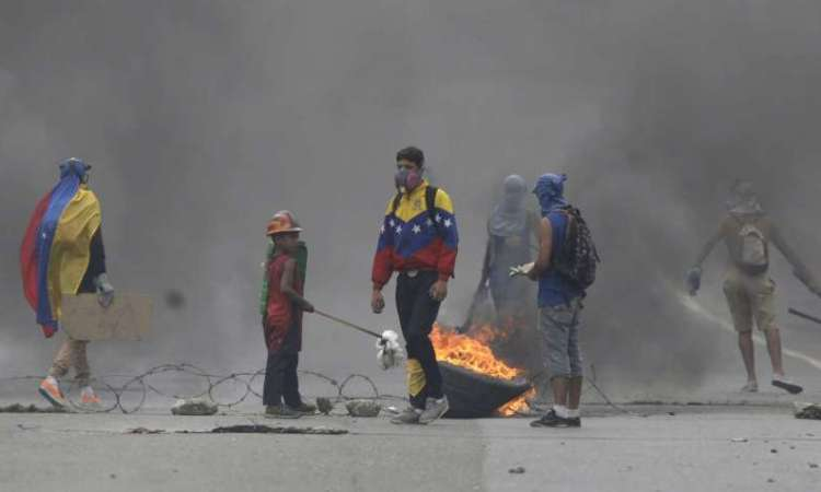 New death in Venezuela puts toll at level of 2014 unrest