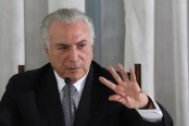 Brazil leader denies report he endorsed bribing ex-lawmaker