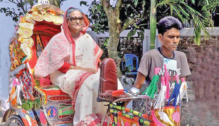 PM takes rickshaw ride in Khaliajuri
