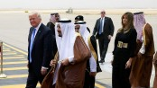 Embattled Trump starts foreign tour with Saudi arms deal