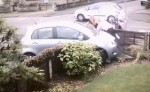 UK family walking on street narrowly escapes car crash (Video)