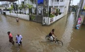 Sri Lanka races to rescue flood victims before rain resumes