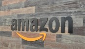 Amazon's stock tops $1,000 for the first time