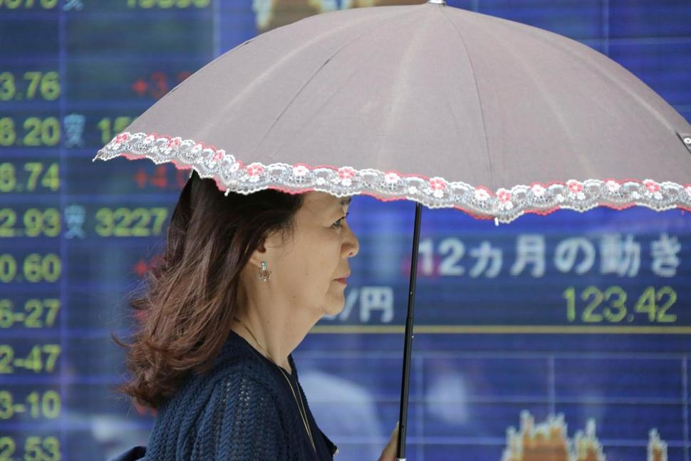Pound falls, Asian shares higher as investors watch UK vote