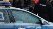 Russia police in standoff with shooter, 4 dead