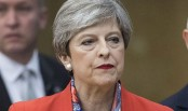 British PM May to face fury of own MPs in battle to keep job