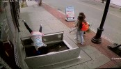 Woman falls into pavement cellar because she was busy with her phone (Video)