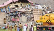 Rescue personnel work at the scene after a seven-storey building collapsed