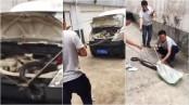 Driver finds a 10ft king cobra hidden under his van bonnet (Video)