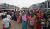 Home-bound people's rush at rail and bus stations