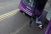 Man hit by speeding bus gets up, walks into bar (Video)