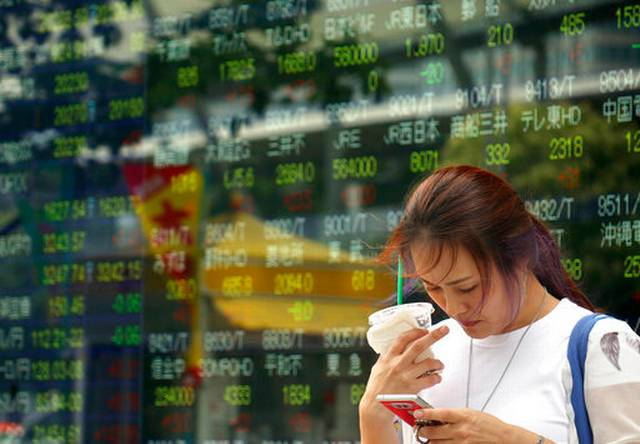 Asian shares drop, tracking Wall St losses, mixed data