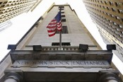 Industrial companies lead US stock indexes mostly higher