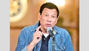 Duterte vows to 'eat militants alive' after beheadings