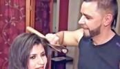 Hairstylist uses hatchet instead of scissors