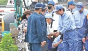 Abe sees devastation in flood-hit areas