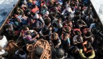 Newborn among migrants reaching Italy after rescue off Libya