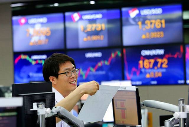 Asian shares mixed in narrow range investors await earnings