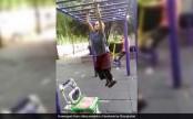 Grandma swings on monkey bar like it's no big deal (Video)