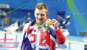 PEATY RETAINS 100M BREASTSTROKE TITLE