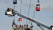 Dozens stranded in mid-air after cable car collision
