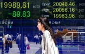 Asian shares mixed as investors on corporate earnings watch