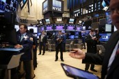 Global stocks rise as Dow ends at another record