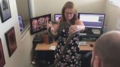 Massive snake found in a newsroom but employee reacts fearlessly (Video)