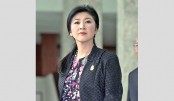 Former Thai PM Yingluck defiant as verdict looms