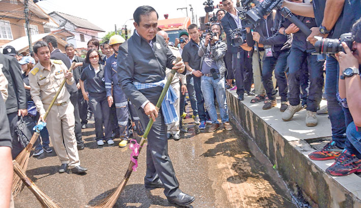 Using a ceremonial broom to help clean