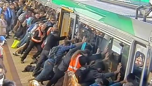 Passengers push train to rescue man stuck in platform gap (Video)