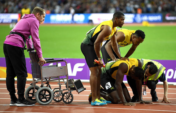 Usain Bolt's last race ends in disaster as he limps out injured