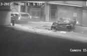 BMW falls 7 floors from parking garage, miraculous escape for driver (Video)