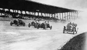 First race is held at the Indianapolis Motor Speedway