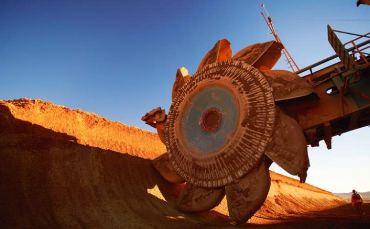 BHP returns to profit, to sell US shale assets