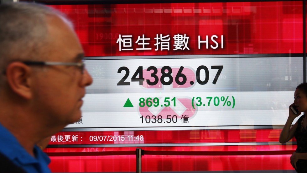 Asian markets mostly up as volatile week draws to close