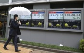 Asian markets lower as cautions prevail over security risks