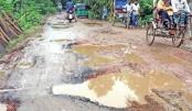 Vehicles struggle to move over Ramganj-Hajiganj Wapda road
