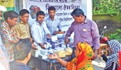 NSU distributes relief materials among flood-hit people