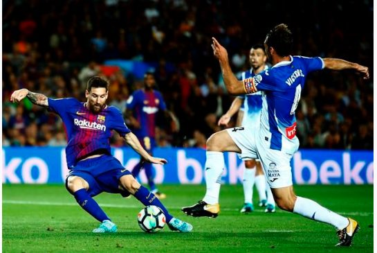 Messi hat trick puts Barca in Liga lead