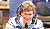 Record-breaking astronauts back on Earth