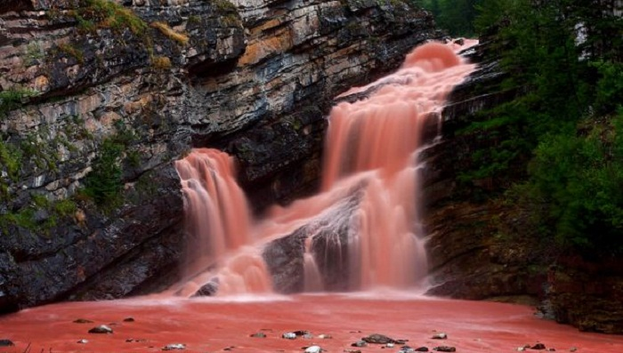 That's a naturally pink waterfall in Canada