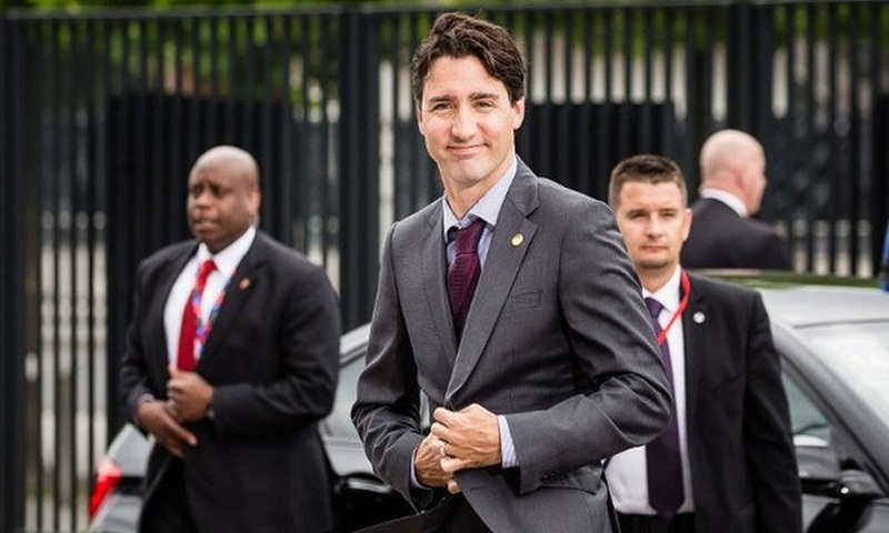 Canada's Trudeau urges Suu Kyi to end Myanmar violence