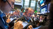 Dow, S&P end at new records, brushing off North Korea, weak data