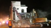 Shanghai demolishes 'nail house' blocking road and traffic